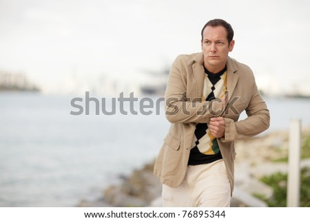 Man pretending to pull out his gun - stock photo