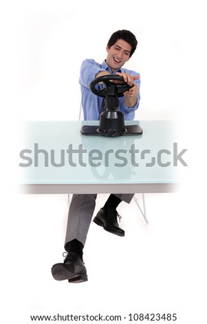 Man pretending to steer a car - stock photo