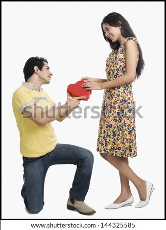 Man proposing to a woman - stock photo