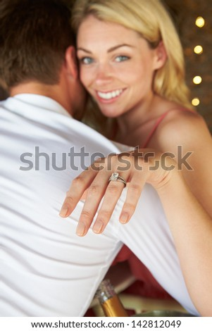 Man Proposing To Woman In Restaurant - stock photo