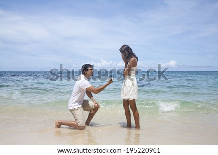 Man proposing to woman on the beach in the Philippines