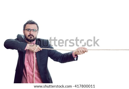 Man pulling a rope - stock photo