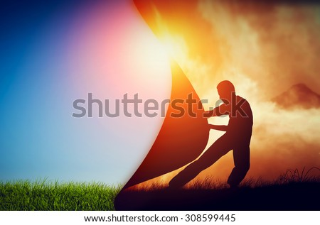 Man pulling curtain of darkness to reveal a new better world. Conceptual change, two worlds, hell and paradise.  - stock photo