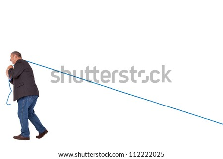Man pulling on rope - stock photo