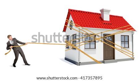 Man pulling rope to move wooden house isolated on white background - stock photo