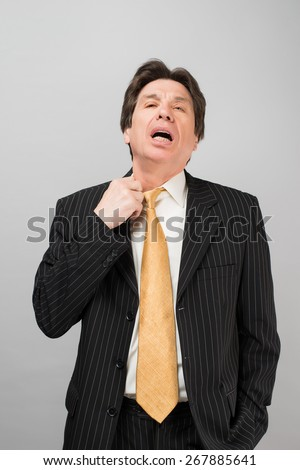 Man pulls his shirt collar - stock photo