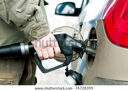 Man pumping fuel  in to the tank