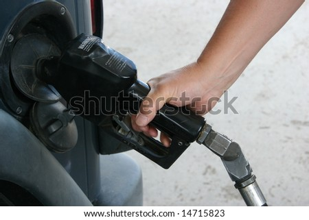 man pumping gas - stock photo