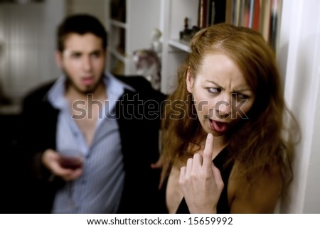 Man pursuing a woman at a party makes her feel sick - stock photo