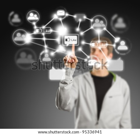 Man push the button in social network on virtual touch pad
