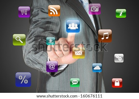 Man pushes social media button on dark background  - stock photo