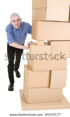 Man pushing heap from cardboard boxes on white