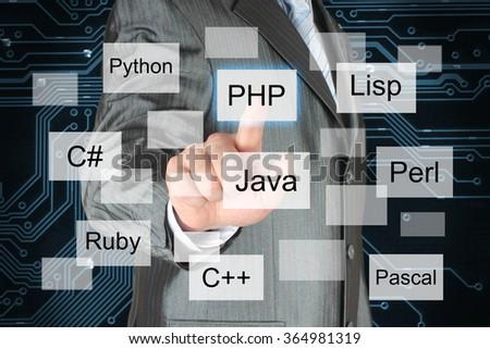 Man pushing virtual programming language button on digital background - stock photo