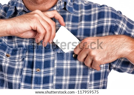 Man puts a blank card in his pocket - stock photo