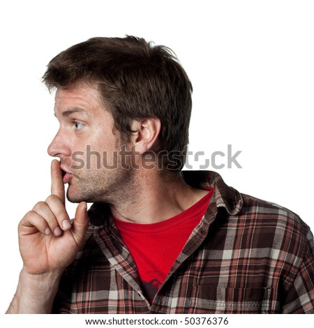Man puts fingers on lips, telling people to be silent - stock photo