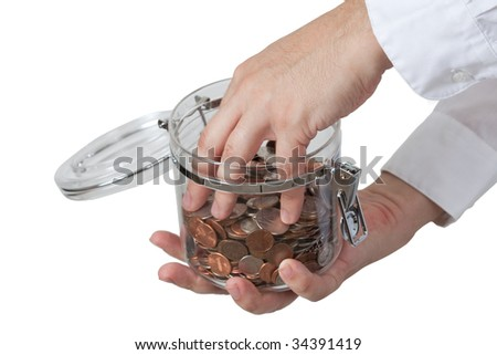 Man puts his hand in the jar full of coins - stock photo