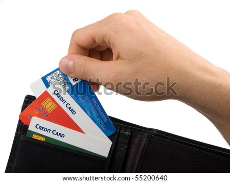 Man puts out credit card from his wallet. Isolated on white background. - stock photo