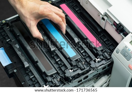 Man puts toner in the printer - stock photo
