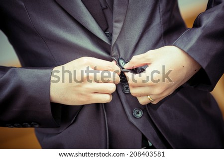 Man putting Button. instagram look - stock photo