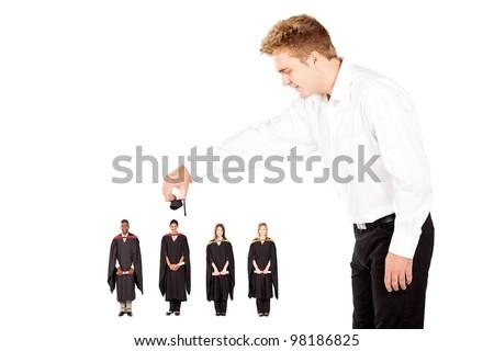 man putting cap on university graduate - stock photo