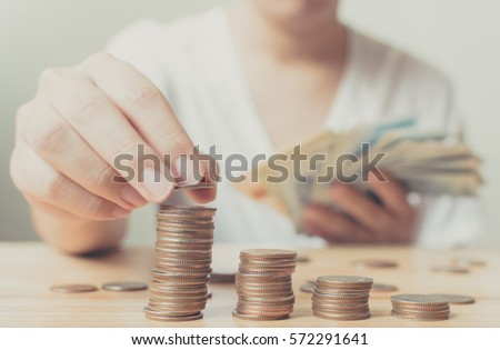 Man putting coins on stack, Concept business financial save money