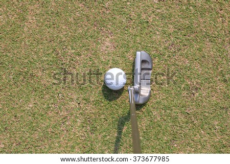 Man putting golf ball