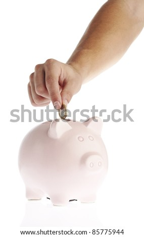 man putting money in piggy bank over white background - stock photo
