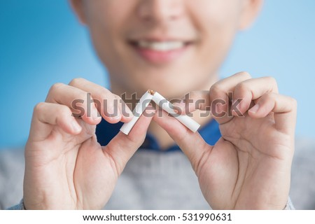 man quit smoking with blue background, asian