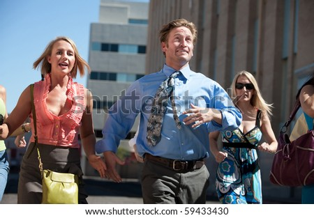 Man races ahead of women in the city. - stock photo