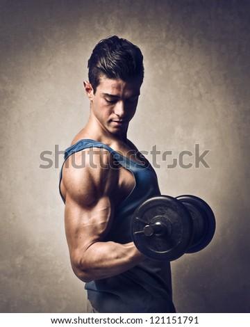 Man raising a dumbbell - stock photo