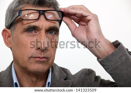 Man raising his glasses - stock photo