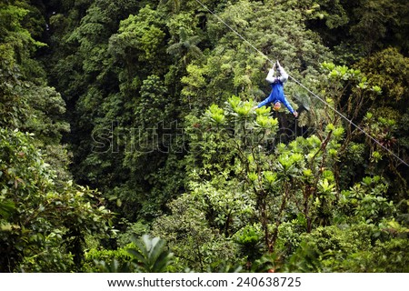 Man Rappelling Upside Down - stock photo