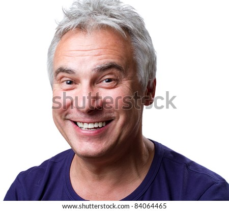 Man reacting and smiling at the camera - stock photo