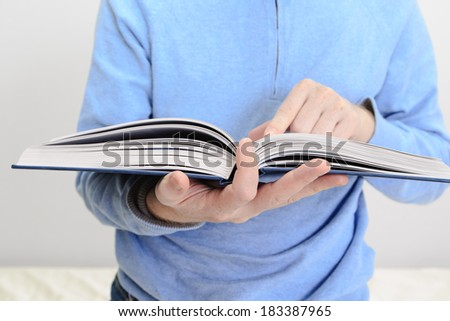 man reading a book - stock photo