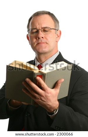 Man reading a book with a unique expression - stock photo
