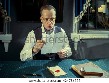 Man reading a letter with unexpected news