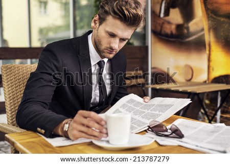 Man reading a newspaper - stock photo