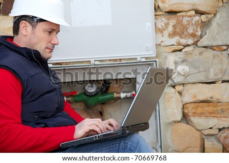 Man reading domestic water consumption - stock photo