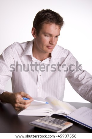 Man reading from a textbook. Concept of studying - stock photo