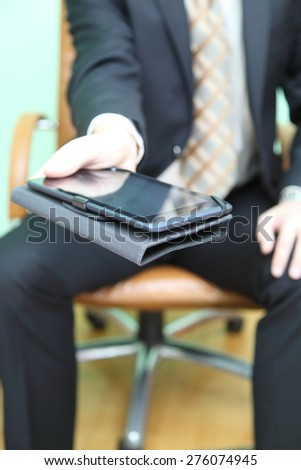 man reading from the tablet - stock photo