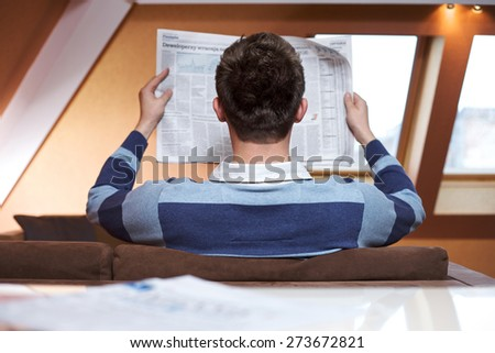Man reading newspaper