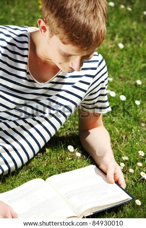 Man reading outdoor - stock photo