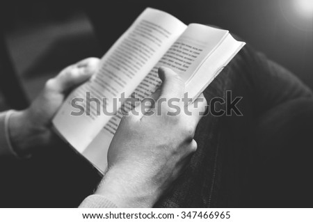 Man reading the book - soft filter - stock photo