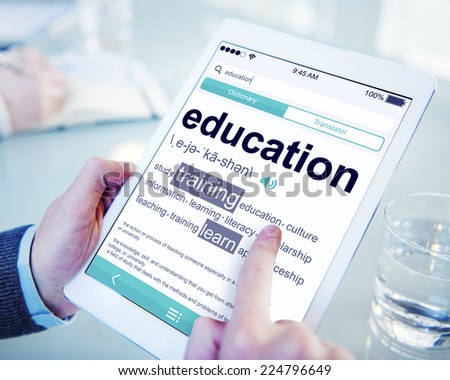 Man Reading the Definition of Education - stock photo