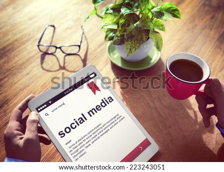 Man Reading the Definition of Social Media - stock photo
