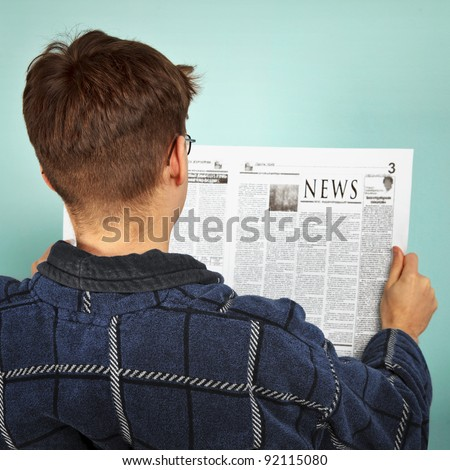 Man reading the newspaper - stock photo