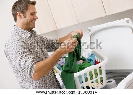 Man Reading Washing Instructions - stock photo