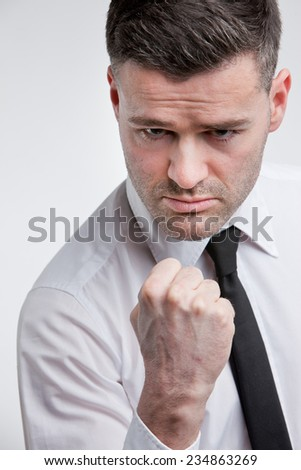 man ready to hit you in the face with his  punch - stock photo