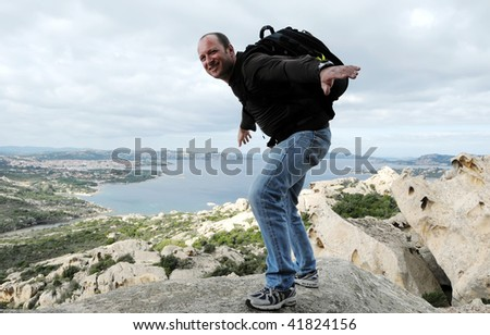 Man ready to jump from rocks