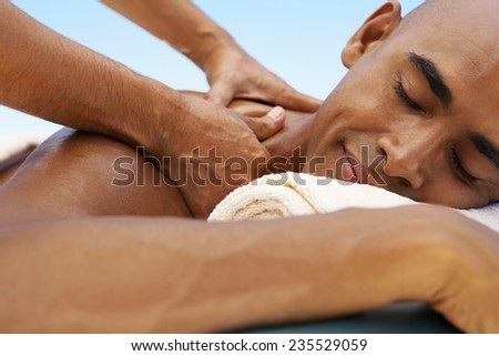 Man Receiving a Massage - stock photo